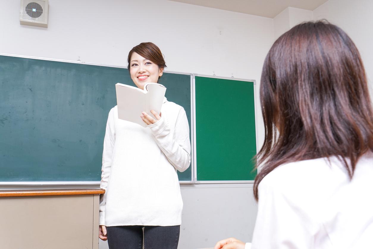 Female teacher having books giving lessons