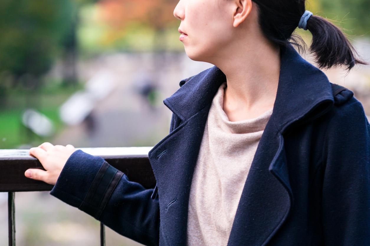Woman watching from a pedestrian overpass